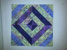 Please vote for this entry by Janice in Accuquilt Quilt Block Contest!