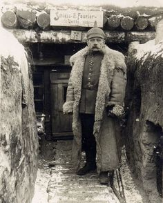 A German officer(?) bundled up for winter on the Eastern Front, c. 1915.