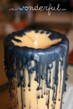 Halloween Candles - broken site page. I would use black candles and let the wax drip down the sides of the large candle. Halloween Candelabra, Halloween Candles, Diy Halloween Decorations, Holidays Halloween, Halloween Crafts, Happy Halloween, Halloween Party, Adult Halloween, Halloween 2019