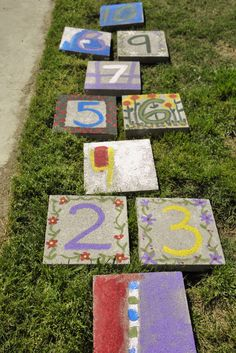 The hopscotch I made with my four year old--acrylic craft paints on concrete stepping stones. Be sure to set the stepping stones down into the grass, to avoid scraping bare feet!