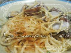 Le Zampe in pasta: Sapore di mare... Spaghetti arselle e bottarga.