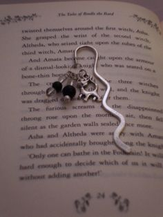 Silver cat bookmark with clear and black beads. £3.50, via Etsy.