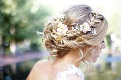 Loose side bun with braid and real flowers (hydrangea blooms and baby's breath)