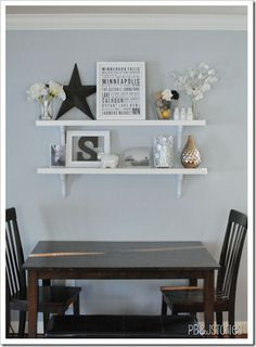 Shelf arrangement idea. Black/dark grey with pops of white and metallic objects.