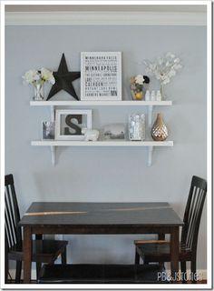 Shelf arrangement idea. Black/dark grey with pops of white and metallic objects.
