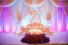 Ooh we love the giant ambi (mango design) on the backdrop! - Reception; Stage; Seat #indian #stage decor