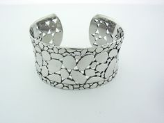 925 Sterling Silver wide Cuff Bracelet inspiered by a famouse designer. This bracelet wights 40 gram.