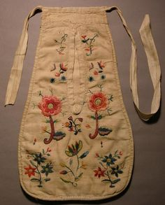 Tie On Pocket, single, embroidered  Dateearly-mid 1700s, Collection Blaise Castle House Museum, Bristol  The front of this pocket is made of twill weave linen & also lined with linen. It is embroidered in colorful wools in flowers, stems and leaves. The back is made of plain weave linen. The tapes are made of linen and form part of the pocket top. The pocket is worn & repaired.Vertical/Openings/Construction, Tape/Attachment/Construction,