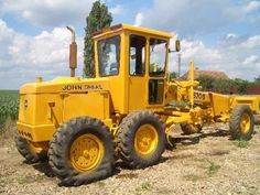 John Deere Construction Grader. Going old school grader on this one.Looks like a 570A