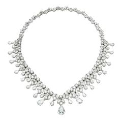 Diamond Necklace/Tiara $750,000 from 1stdibs.com.  96cts of Pear Shape and Brilliant Cut Diamonds.  Has the versatility to be worn as either a necklace or a tiara.