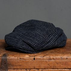 18 Waits | Billy Cap | Faded Indigo Dots $115  Billy Caps are hand-made in Montreal. Based on a vintage pattern and updated by 18 Waits. Wool is sourced from Woolrich Woolen Mills in Pennsylvania. This Fall/Winter we are offering three variations: charcoal herringbone, light grey herringbone, and brown plaid. Trimmed with a super-soft leather sweatband.