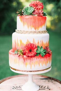 Eclectic pink and orange wedding cake - we love the succulents! | Kati Rosado Photography
