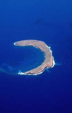The largely submerged volcanic crater of Molokini rises 160 feet above the ocean and the land area is about 18 acres - Maui, Hawaii EPIC snorkeling