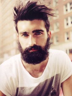 Blue eyes, wild hair, beard