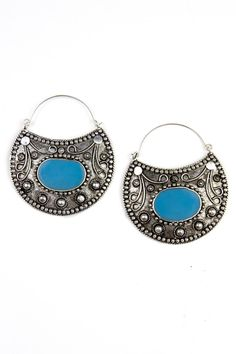 "Approx length from ear 2.5"" Lovely gypsy hoop drop statement earrings with a blue stone. Nickel Free Earrings are a great gift for moms, sisters, aunts and daughters. Style Tip: It is all about accessorizing. Make any outfit go from casual to glam with Fashion Pickle statement jewelry. Simple long necklaces to chunky chokers, they never go out of style. Ear hooks, bracelets, bangles, rings, anklets and body chains are the best way to make your clothes look completely different each time you…"