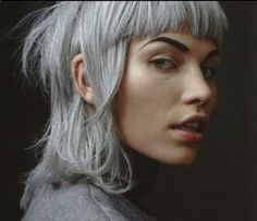 full platinum on a shaggy neo-rocker cut with contrasting sharp wide romulan-esque fringe