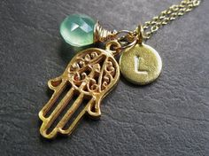 Hamsa - hand of protection.  I want this with my birthstone & initial (duh!).