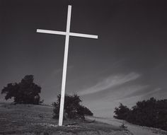 1932 White Cross, San Rafael, California [plain white cross, slightly tilted, on hilltop with scattered trees, wispy clouds] by Ansel Adams 78.152.83