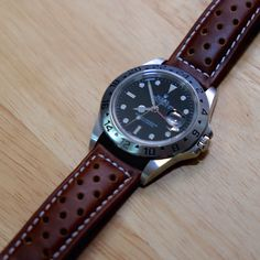 Rolex Explorer 2 with leather strap.