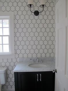 The wallpaper in the powder room is Schumacher.  From the Modern Nature Collection.  Tracery  5005121 Charcoal.