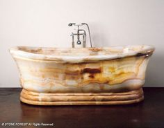 Old World Bathtub in white onyx by Stone Forest