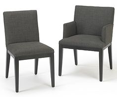 Square back dining chairs with and without arms shown in a cleanable dark slate textured fabric and espresso finish on legs and base. Available in other fabrics and finishes.