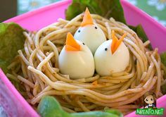 Baby Chicks Bento: spagetti for the nest, hardboiled egges for the baby chicks and carrots for the beaks with nori for the eyes