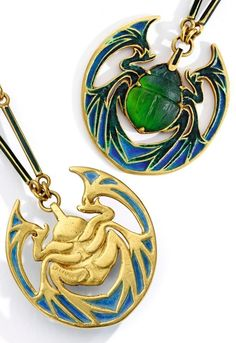 René Lalique - An Art Nouveau 18 Karat Gold, Moulded Glass and Enamel Necklace, Circa 1900. The baton-shaped links applied with dark green enamel, suspending a pendant in the form of a green moulded glass scarab, the legs and wings highlighted in green an