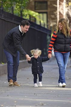 Doting parents: Both Fallon and his wife showed no signs of strife as they held on tightly...