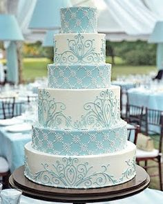 Gorgeous 6 tier round wedding cake in pale baby blue and white with delicate damask patterns
