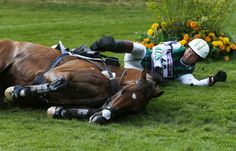 Australia's Clayton Fredericks lays near his horse Bendigo as he fell down while competing in the Eventing Cross Country equestrian event at the London 2012 Olympic Games in Greenwich Park, July 30, 2012.