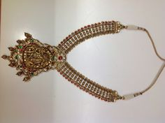"""Traditional Indian studded jewellery have crafting of Lord Krishna and Radhikaji, known as """"Temple collection"""""""
