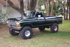Dark Green 78 or 79 Ford truck