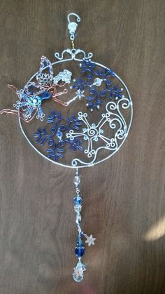 Frozen fairy sun catcher beaded wire wrapped.
