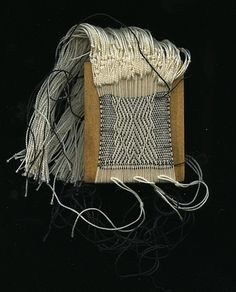 Textile Art: Weaving with cotton on wood by Laura Fischer