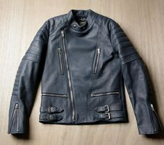Looking for this jacket but with a small collar, I have an old one thats very beat up but the style works perfectly with me (slim build and hard shoulder line :) ) Anyone know who made it?      Unused Navy Leather Biker Jacket for F/W 2011 | Por Homme - Men's Lifestyle, Fashion, Footwear and Culture Magazine
