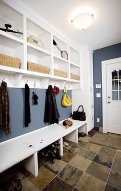 I like how this keeps the room feeling more open as opposed to visually taking up space by adding individual cubbies. Ideal for a small or narrow mudroom.