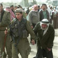 An IDF soldier helping an older Arab man. This picture shows the truth about what Israeli soldiers are really like.