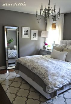 Mercury glass like this jug from HomeGoods and mirrored pieces add sparkle to this gray and white bedroom. Sponsored Pin