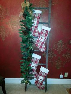 Antique ladder as a stocking holder. I think with the right tools I can make this cute.