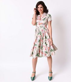 Take us away, gals! Fresh from Hell Bunny in a 1940s vintage dress style, the Paradise dress is a chiffon frock that's lightweight and luxuriously comfortable. A collared v-neck bodice boasts fluttery short sleeves and a faux wooden button up front, darte