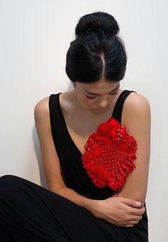 Yuni Kim Lang Brooch: Big Red Knots, 2013 Red cords Photo by Matjaz Tancic