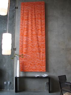 Decorating Tall Walls Design Ideas, Pictures, Remodel, and Decor - page 2.  Using fabric as a decorative element instead of art to break up all the wall but bring the eye up.