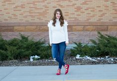 White and Red Valentines Day Outfit. Gorgeous white ruffle sweater with distressed jeans and red lace up flats. Outfit Idea for winter, Valentine's Day, or Date night