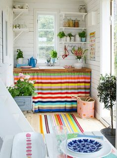 the splashes of bright color used in this small space make it more interesting and makes you forget how small the space really is