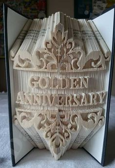 Create your own piece of stunning Book Art with this Golden Anniversary Combi Cut and Fold Book Folding Pattern. Old Book Crafts, Book Page Crafts, Cut And Fold Books, Paper Art, Paper Crafts, Book Folding Patterns, Art Patterns, Folded Book Art, Golden Anniversary