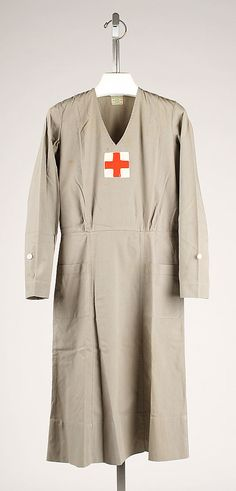 of 2 photos) Grey cotton nurse's uniform by Mainbocher, American. Worn with matching nurse's cap. Vintage Nurse, Vintage Medical, 1940s Fashion, Vintage Fashion, 1940s Woman, We Wear, How To Wear, 20th Century Fashion, American Red Cross