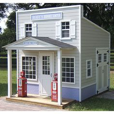 Country Roads Gas Station.  Features include side garage-style doors, interior tire rack, checkout counter, ceiling light, air conditioning, and even realistic-looking gas pumps that make a clicking sound.