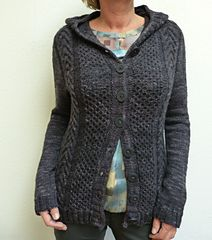 This cardigan features two different cable textures. It is worked seamlessly from the top down with saddle shoulders and modified contiguous sleeve shaping. The body length can be easily modified, if preferred. The pattern includes video tutorial on how to work minicables without cable needle. You have to be able to read charts for this pattern.