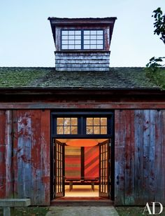 The games barn is one of several outbuildings on the property | archdigest.com